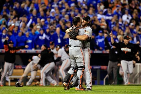 The San Francisco Giants, behind Madison Bumgarner, hoist the trophy yet again. (Photo by Jamie Squire/Getty Images)