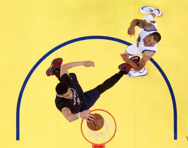 Anthony Davis skies for two of his 35 points, but the Pelicans rally fell short in Game 1 against heavily favored Golden State. (AP Photo/Marcio Jose Sanchez, Pool)