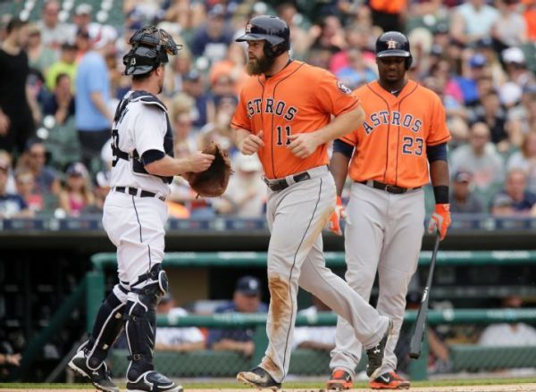 The Astros lead the AL West behind powerful bats, like those of Evan Gattis and Chris Carter, and in spite of low batting averages. (AP Photo/Duane Burleson)
