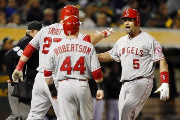 Albert Pujols celebrates with his Angels teammates after his grand slam Tuesday evening that turned a 7-5 deficit into a 9-7 lead. (Photo by Brian Bahr/Getty Images)